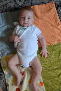 Here is a cute baby showing off his favorite bib.