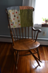 there were several babies rocked in this rocking chair