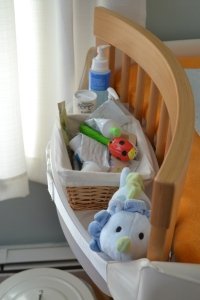 The left bin holds diaper cream, a brush and comb, lotion, and a toy -- a must once your baby starts rolling over and needs distraction