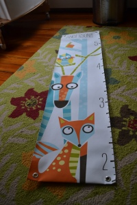 hanging this growth chart that we received as a gift